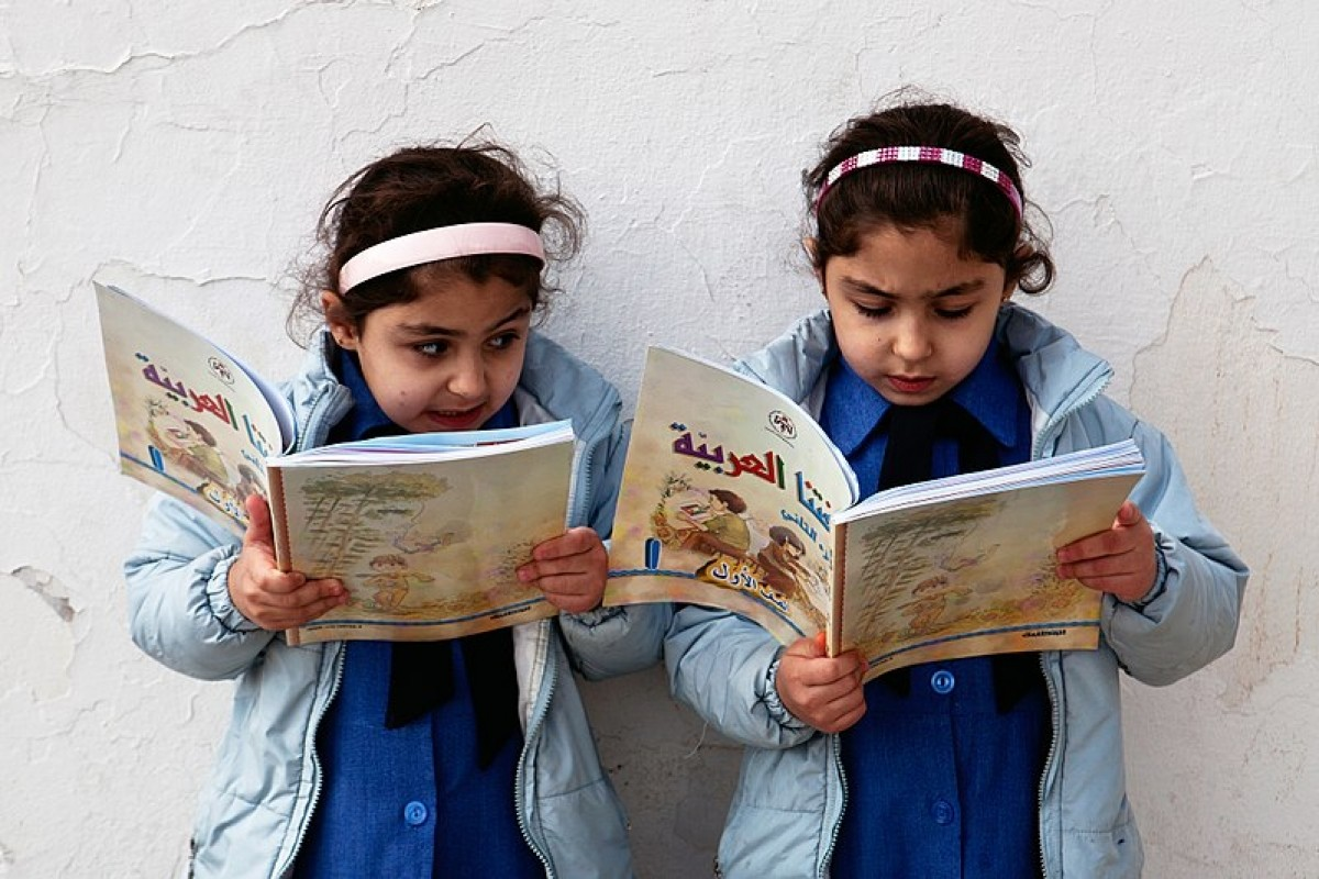 Two school girls reading in Amman, Jordan. Tanya Habjouqa [CC BY-SA 3.0-igo]