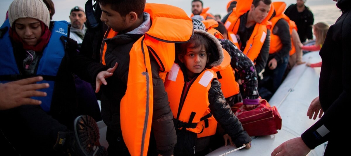 Refugees arrive by rubber raft from Turkey to the Greek island of Lesbos near the port city of Mytilene, Greece,