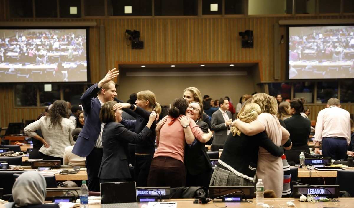 Delegates rejoicing over the adoption of the UNCSW63 Agreed Conclusions.